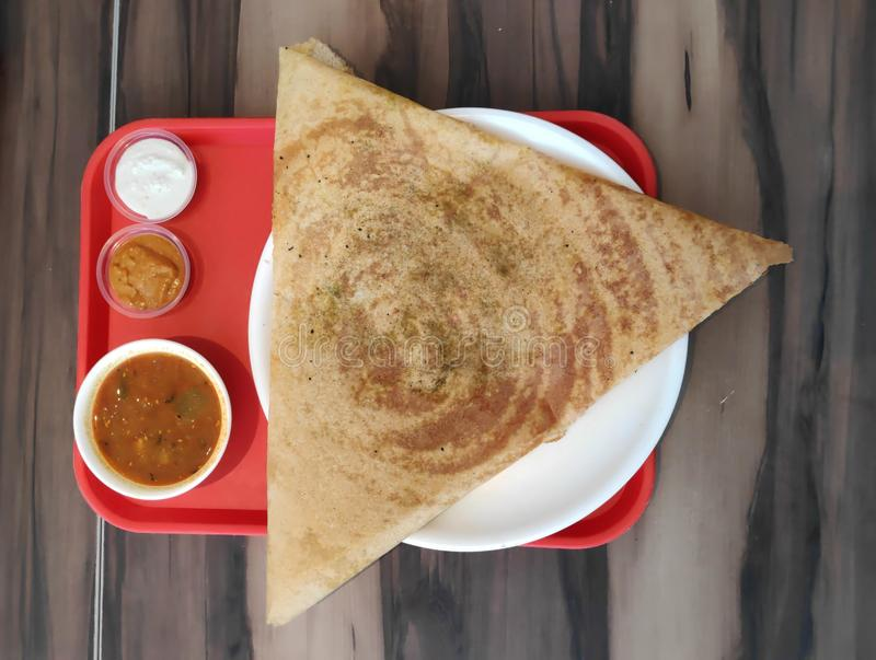 Designer South Indian Dosa Food. Triangle Designer South Indian Dosa and chutney with sambhar indian food stock photography