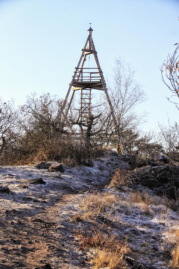 Triangle outlook tower on the hill top. Wooden triangle outlook tower on winter hill royalty free stock photo