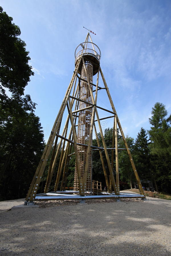 Triangle outlook tower. Triangle wooden modern high outlook tower stock photo