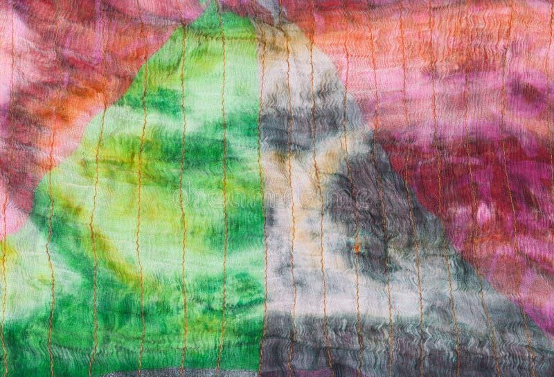 Triangle pattern on stitched silk batik stock image