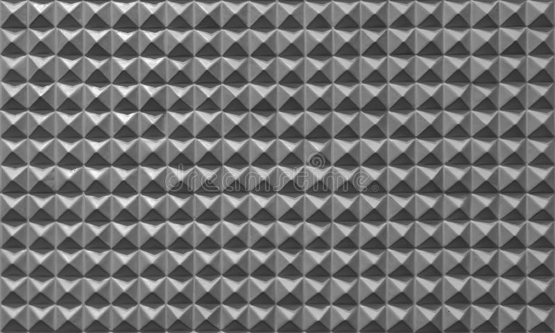 Triangle pyramid tiles pattern surface texture. Close-up of architecture interior material for design decoration background stock images