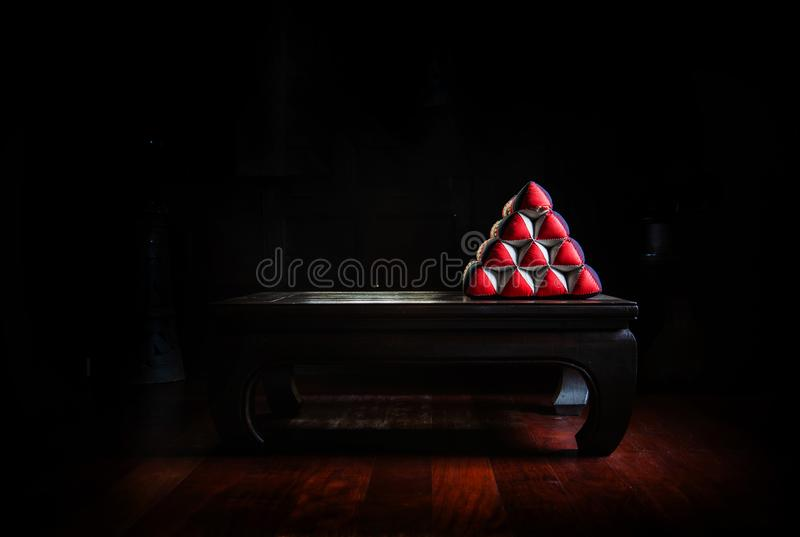 Triangle shape pillow vintage object Thai style on wood table royalty free stock images