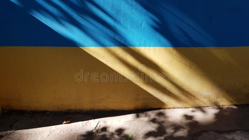 Triangle shape shadow on two-colored wall with blurry shadows royalty free stock photography