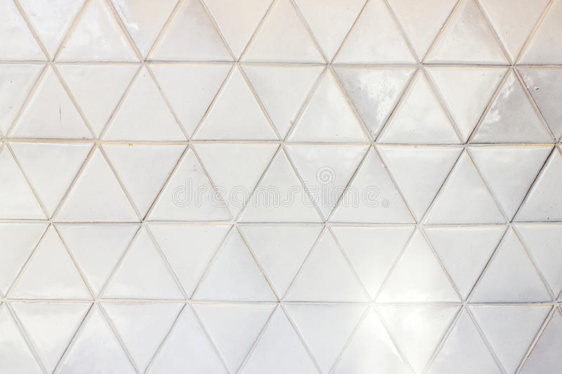 Triangle shaped ceramic tiles wall background. Triangle shaped ceramic tiles wall texture background royalty free stock images