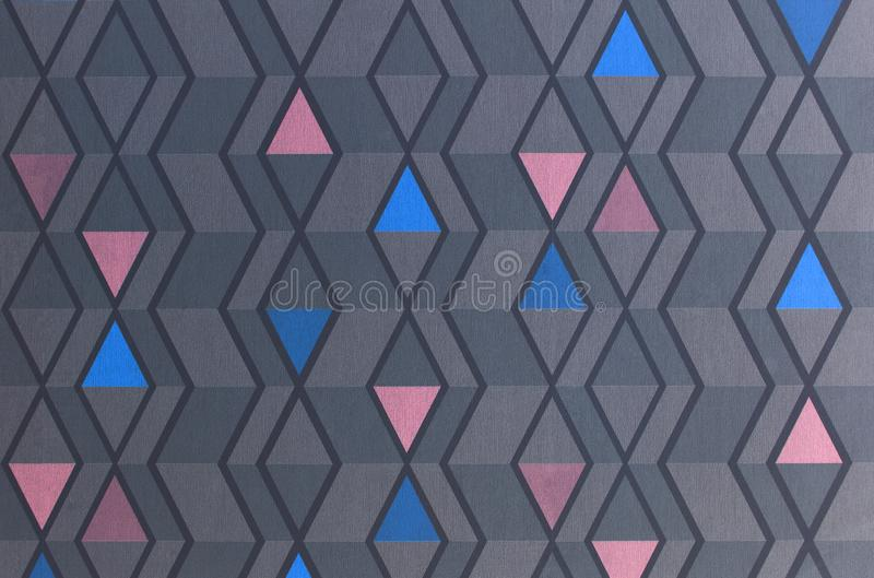 Triangles pattern on the texture of space, abstract background. A simple geometric illustration. Blue, gray and pink triangles royalty free stock photo