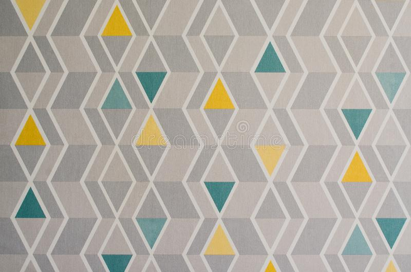 Triangles pattern on the texture of space, abstract background. Simple geometric illustration. Yellow, gray and green triangles royalty free stock photos