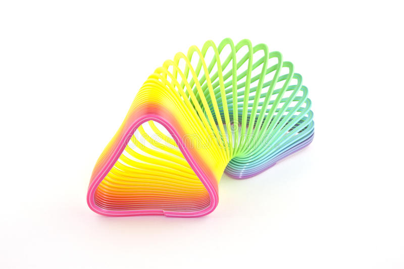 Triangleshaped slinky. On a white background royalty free stock photography