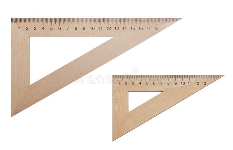 Triangulär linjal som två göras av trä 20 och 15 cm på en vit, isolerad bakgrund arkivbilder