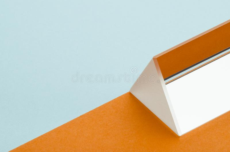 Triangular prism on orange-blue background. Minimalism, abstraction royalty free stock photo