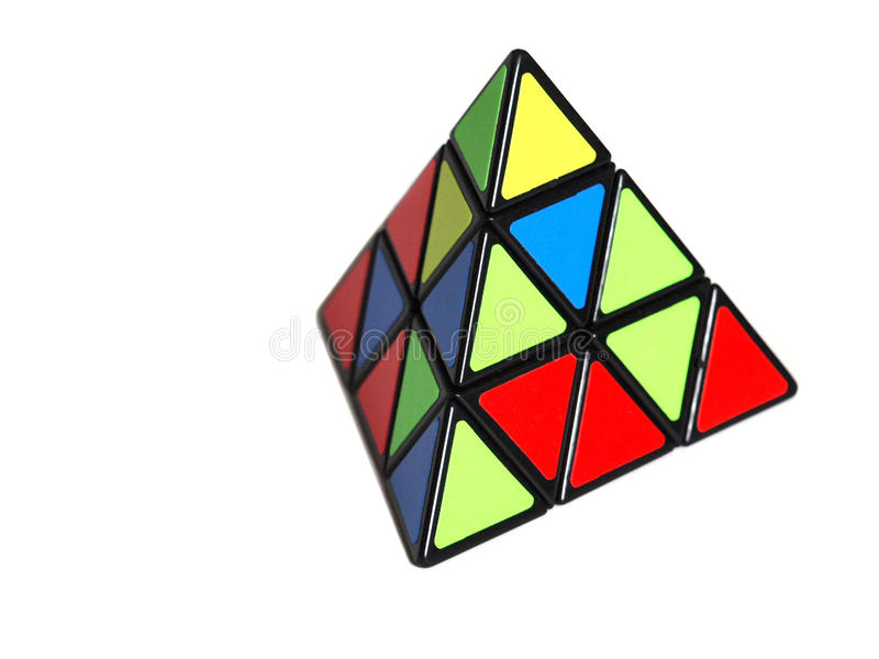 Triangular rubik`s cube. Rubik`s cube in a shape of a pyramid isolated on white background royalty free stock images