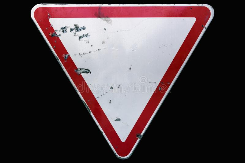 Triangular scratched red border road sign `Yield` isolated on bl royalty free stock images