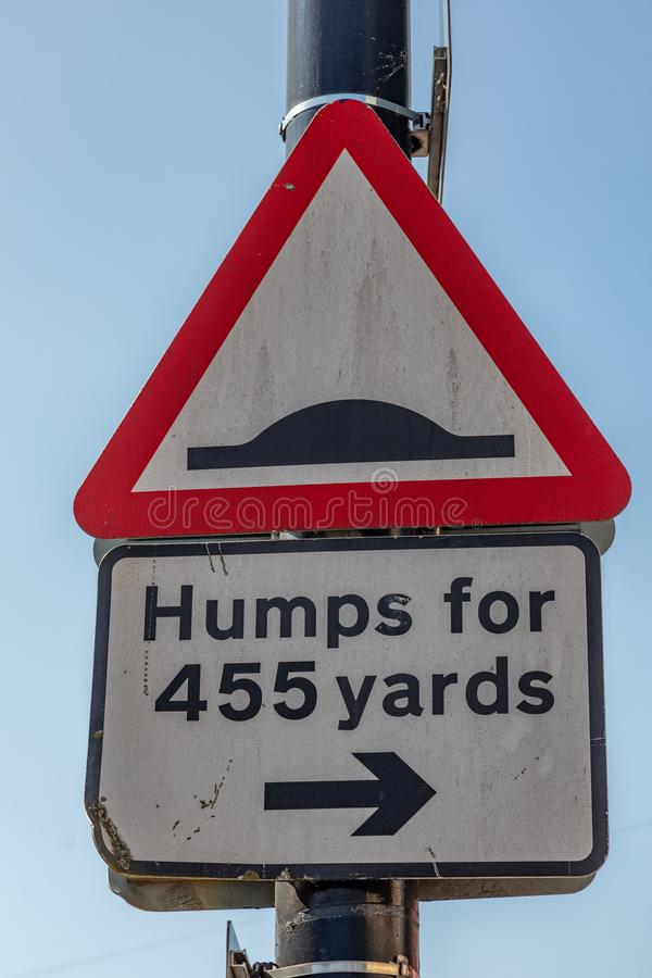 Triangular street sign warning of road humps Widnes April 2019 royalty free stock photo