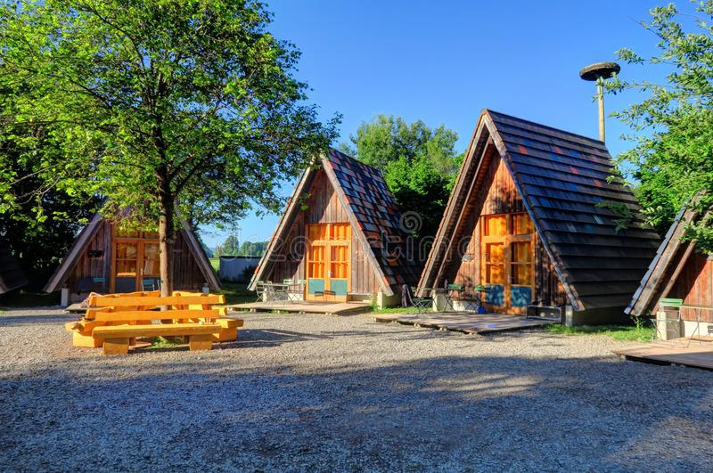 Wooden lodges at sunset in Legau, Germany royalty free stock photos