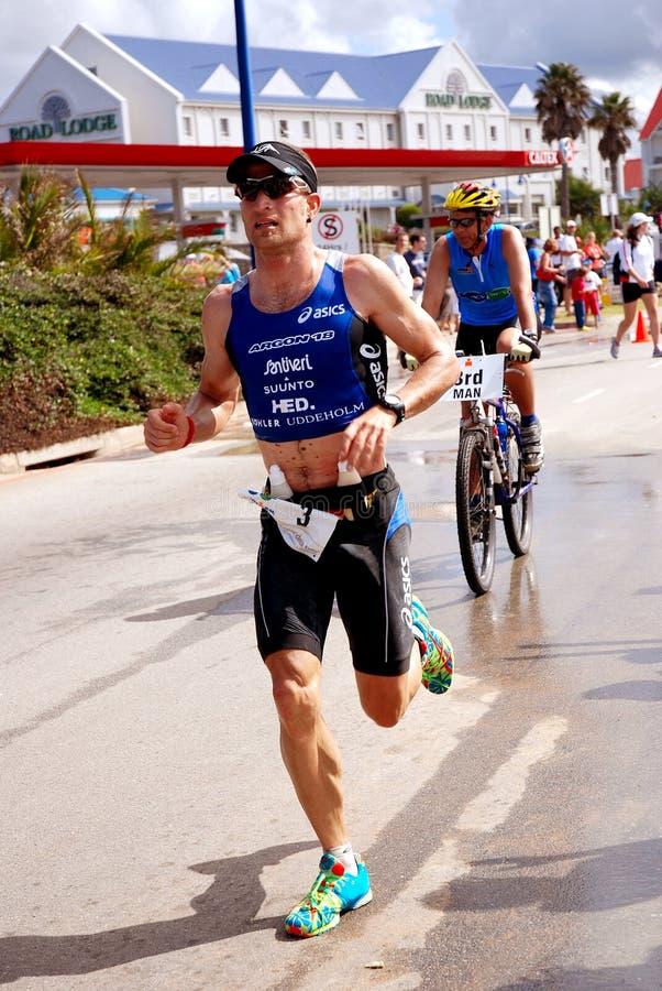 Triathlet Marcel Zamora Perez (Espagne) d'Ironman photographie stock libre de droits