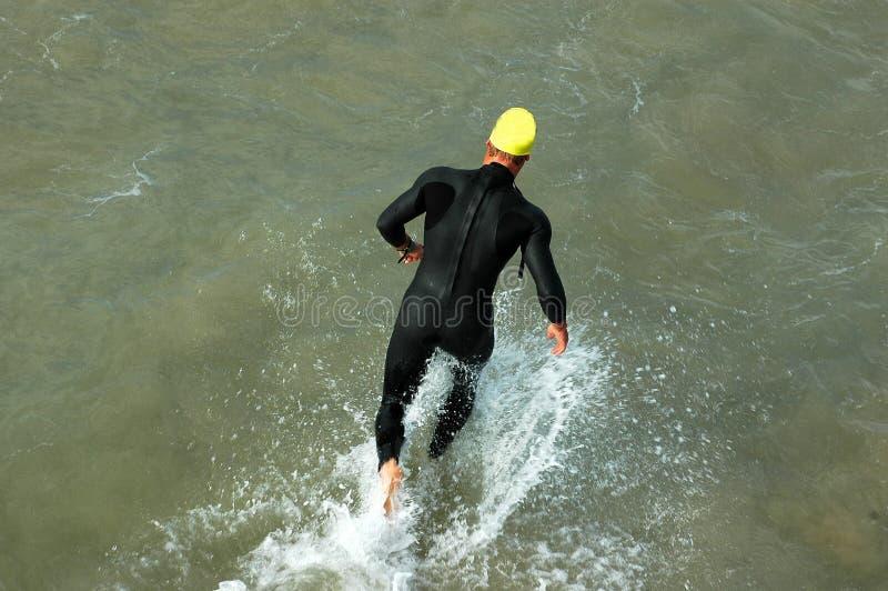 Triathlete corrente fotografia stock