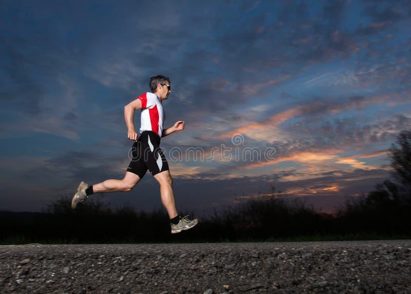 Triathlete courant photo stock