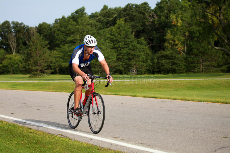 Triathlete Cycling stock images