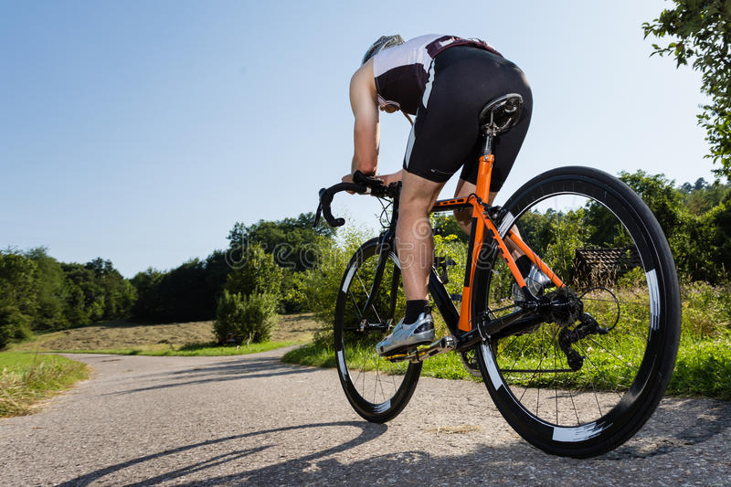 A triathlete is cycling stock images