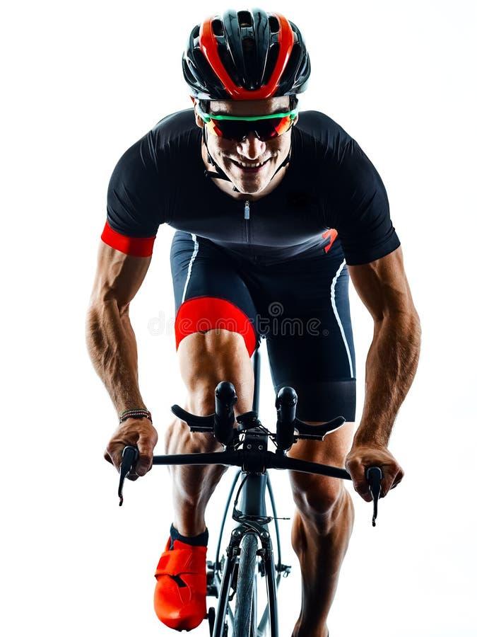 Triathlete triathlon Cyclist cycling silhouette isolated white b. Triathlete triathlon Cyclist cycling in studio silhouette shadow isolated on white background stock image