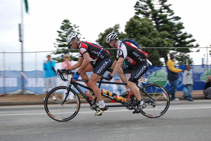 Triathletes Francois Jacobs And Jurie Krige Both South Africa Cycling Together On A Tandem Bike In The Ironman Triathlon Race Port Elizabeth