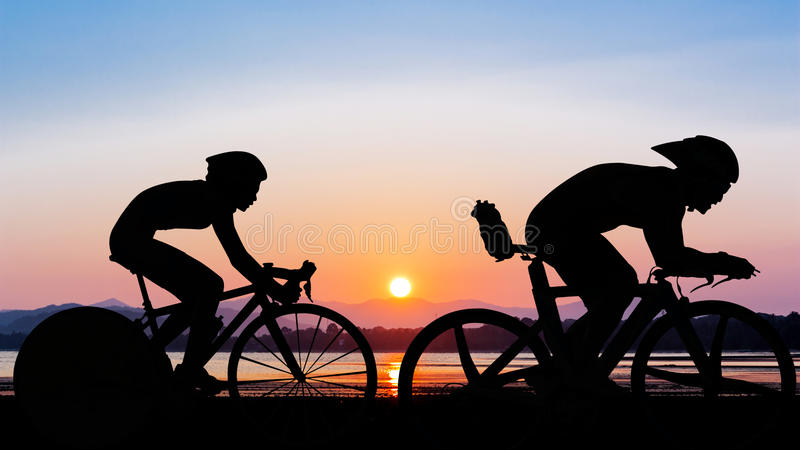 Triathlon at the beach evening time stock images
