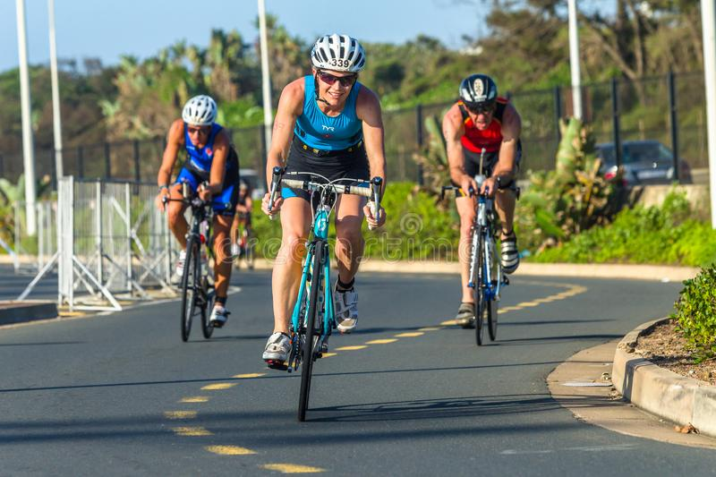 Triathlon Champs Athletes Woman Cycling Road Action royalty free stock photos