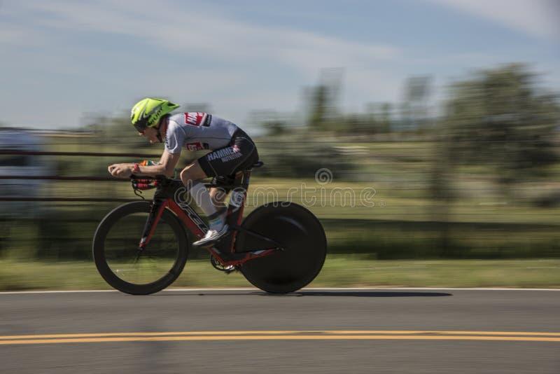 Triathlon racer. Panning photo of triathlon racer . Boulder Triathlon . Boulder Colorado royalty free stock photo