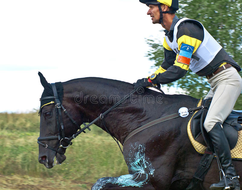 Triathlon in Russia, horseback jumping royalty free stock image
