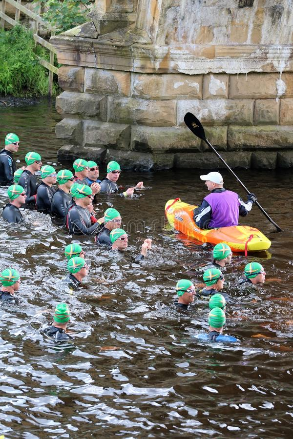 Triathlon triathlete sport healthy exercise swim. Triathletes ready for the start of the swimming at the Peak District Triathlon in Derbyshire, England stock images
