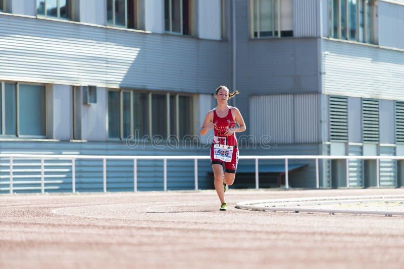 Triathlon woman stock image