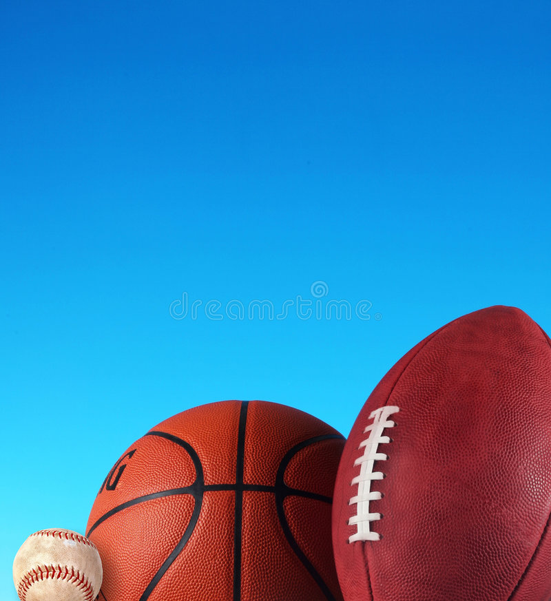 Triatholon, três esportes, basebol, basquetebol, futebol, Winnin foto de stock