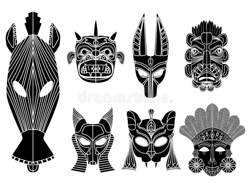 Tribal mask set. Tribal masks, ornamental elemets set over white background stock illustration