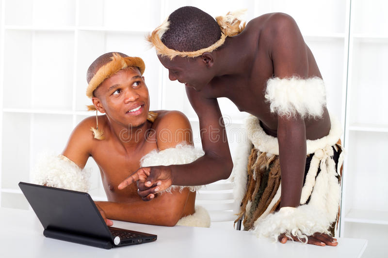 Tribal men learning computer royalty free stock image