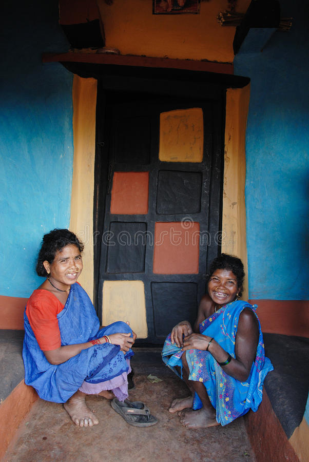 Tribal People in India. Koraput,Orissa,India,January 29,2011-Tribal women smiling at their painted house in Orissa stock photo