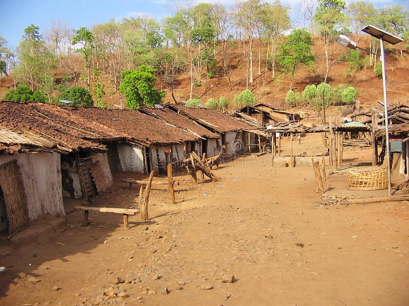 Tribal village. A tribal village in tribal area of Melghat, Chikhaldara, India. Homes are are wooden and are crippled. Government tries to bring some changes by stock images