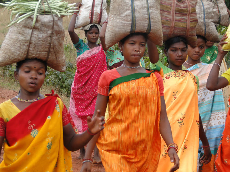 Tribal women carry goods  on their heads