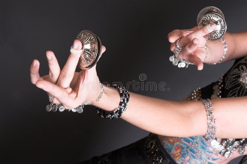 Tribal Zagat. Belly Dancer hands holding Tribal Zagat or finger symbols stock image