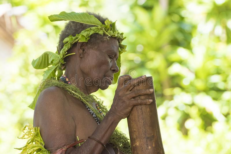 Tribeswoman during ceremony stamping the rhythms royalty free stock photography