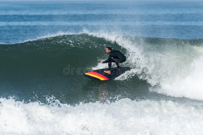 Tribune op Peddel surfer stock foto