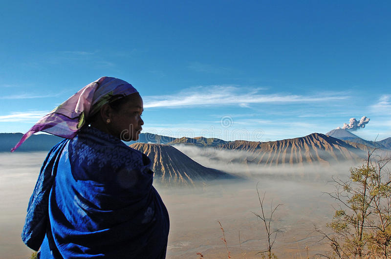 Tengger. EAST JAVA, INDONESIA, AUGUST 2007 - Tengger tribal women in the crater of Mount Bromo, East Java, Indonesia. Mount Bromo is a cluster of volcanoes in stock photography