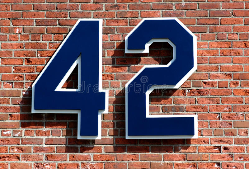 Tribute to Jacke Robinson. The number 42 for Hall of Famer Jackie Robinson hangs outside Fenway Park, Boston, MA stock photography