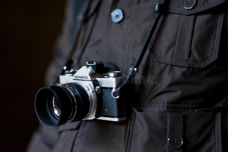 A tribute to Olympus: vintage OM camera. Olympus Corporation is facing a big internal economic scandal. Shares are falling very quickly during these days, news stock photo