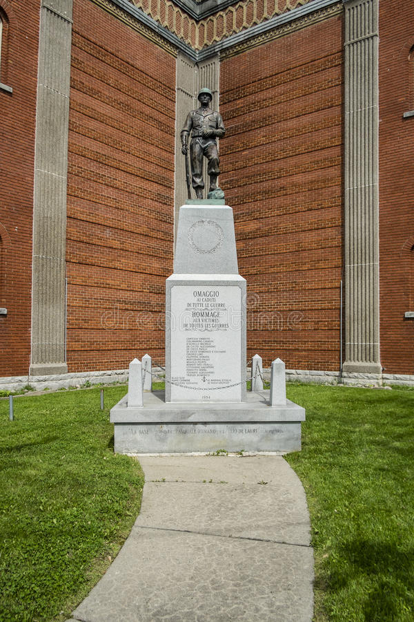 Tribute to the victims of all wars. Statue tribute in front of The Church of the Madonna della Difesa Italian: Chiesa della Madonna della Difesa, French: É stock photos