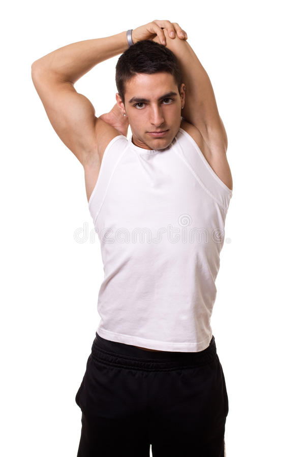Tricep Stretch. Behind-head tricep stretch. Studio shot over white royalty free stock images