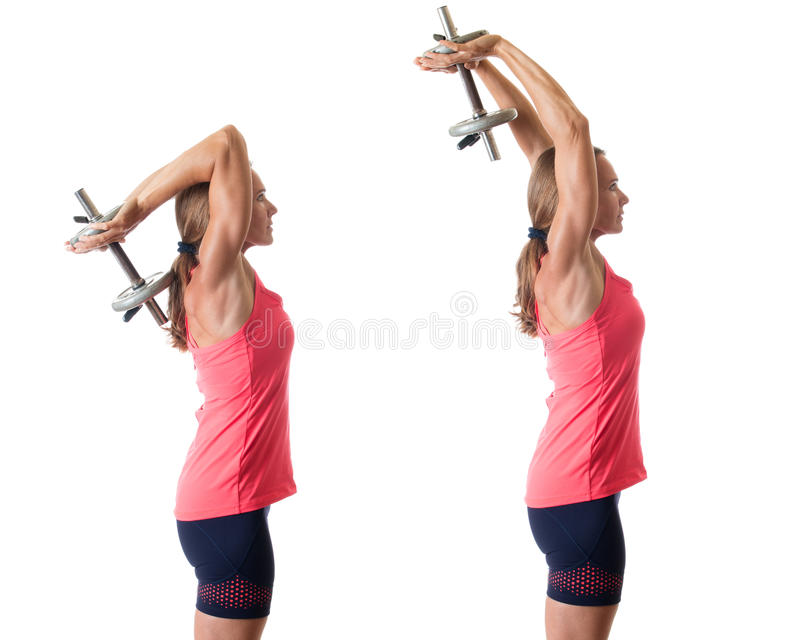 Triceps Extension. Overhead triceps extension exercise. Studio shot over white royalty free stock photo