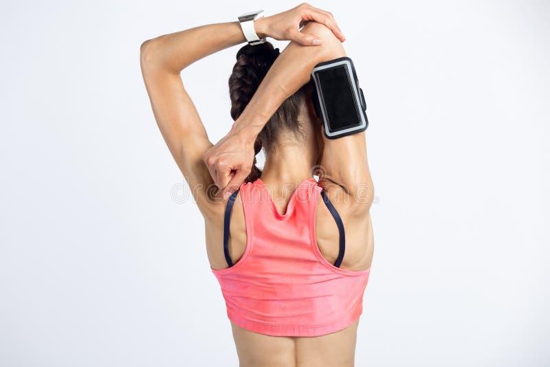 Triceps rozciągliwości ćwiczenie zdjęcie stock