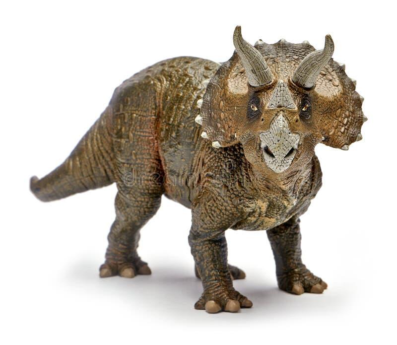 Triceratops dinosaurieleksak för främre sikt som isoleras på vit bakgrund med den snabba banan arkivbild
