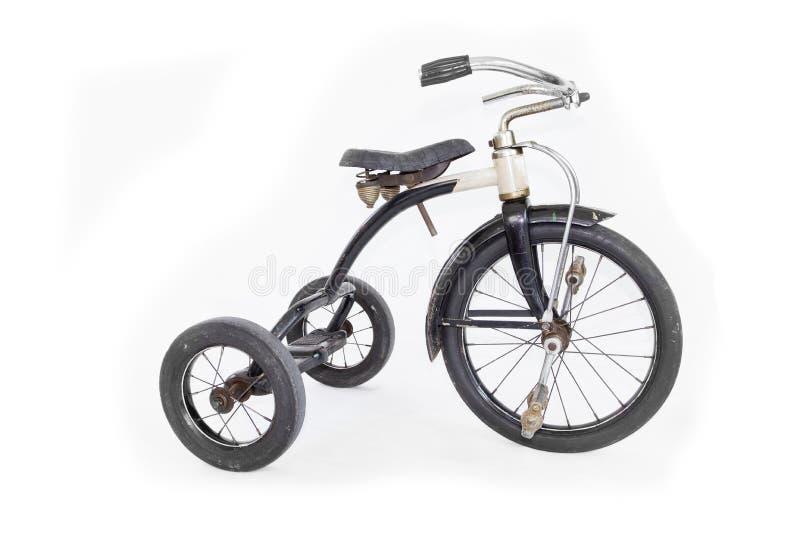 Triciclo d'annata isolato su fondo bianco fotografia stock