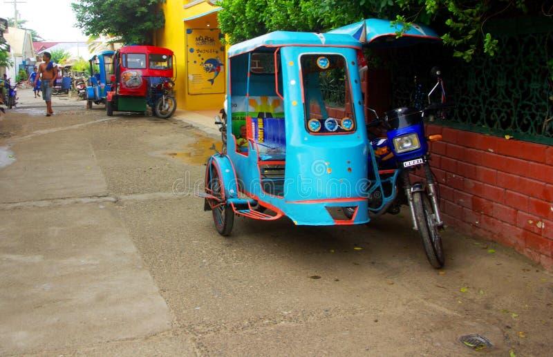 Triciclo de Moalboal - transporte local fotografía de archivo