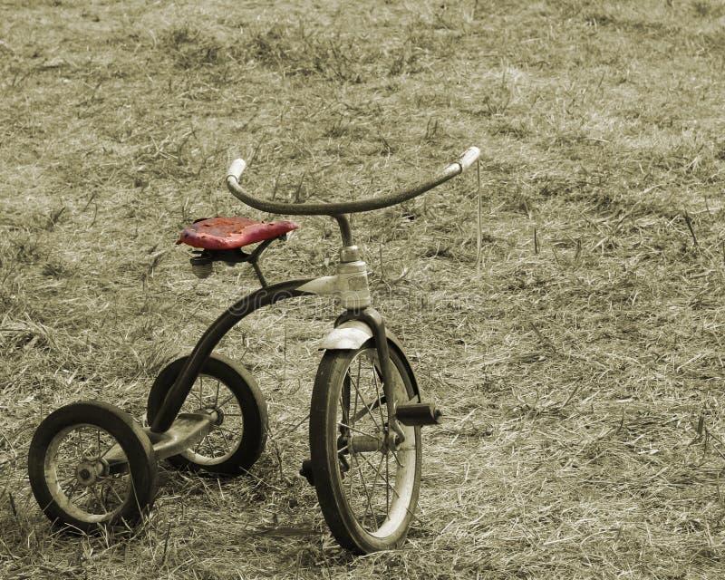 Triciclo do Sepia do vintage imagens de stock royalty free